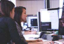 Women working ahead: two women work at a computer for a startup company