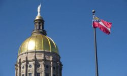 Georgia-Capitol-and-Flag-696x464